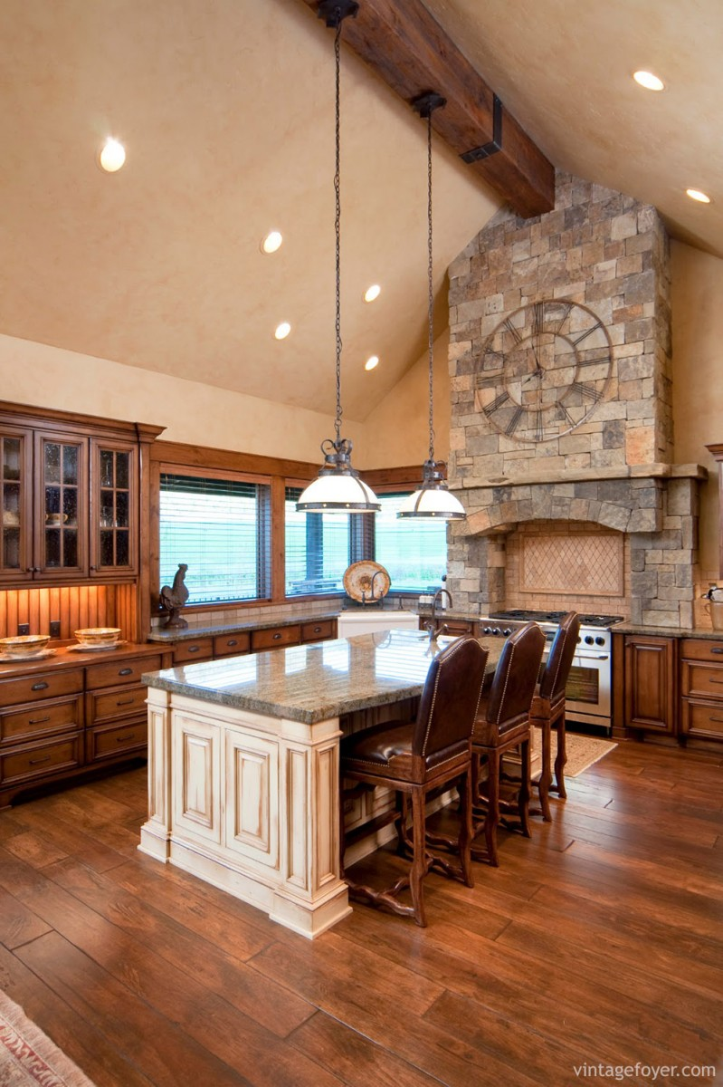 Beautiful stained wood cabinets and natural wood flooring: this kitchen is rustic and welcoming, spacious yet comfortable.