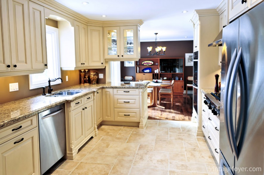 If you don't have much kitchen space but are looking for a change, try cream-colored cabinets and a warm, marble counter top, combined with matching tiled or laminate flooring.
