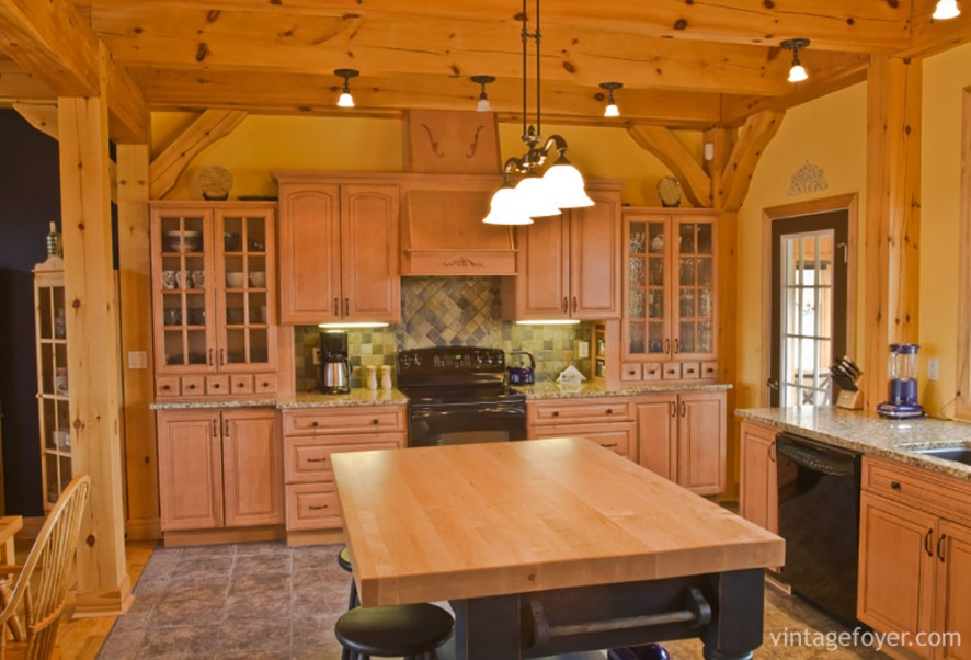 Warm, rustic, and natural, this kitchen has all the components of a cabin-in-the-woods style home. The exposed wood ceiling and the matching cabinets exude a feeling of country-style living.