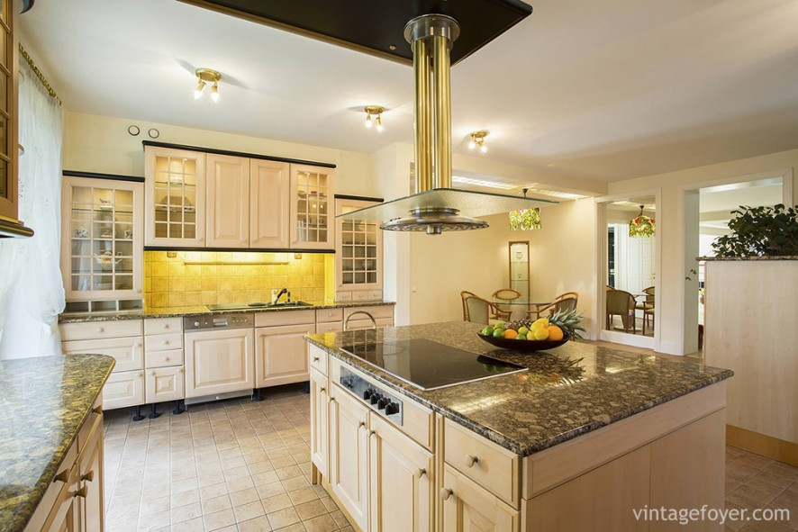 If you're looking for something cheerful, try a burst of yellow, along with cream-colored cabinets and flooring.
