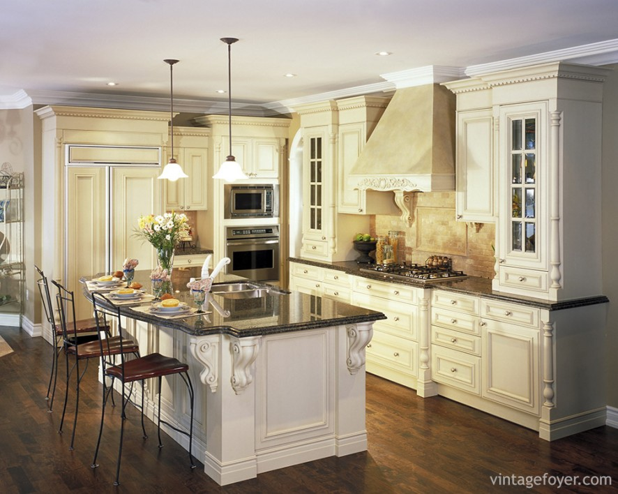 Classic and sophisticated, this kitchen uses Greco-Roman style moldings and paneling to enhance the look and feel of this space.