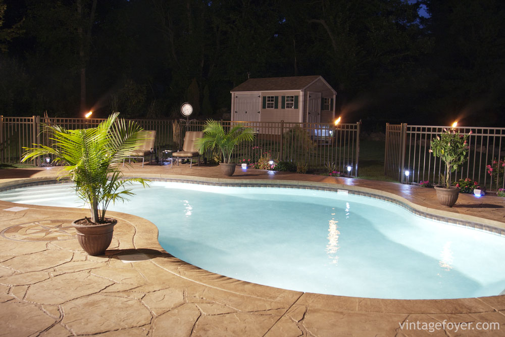 The Slate Stone Used For Patio This In Ground Pool Help Accent Dazzling Light Of Tiki Torches Provides A Homely Feel To