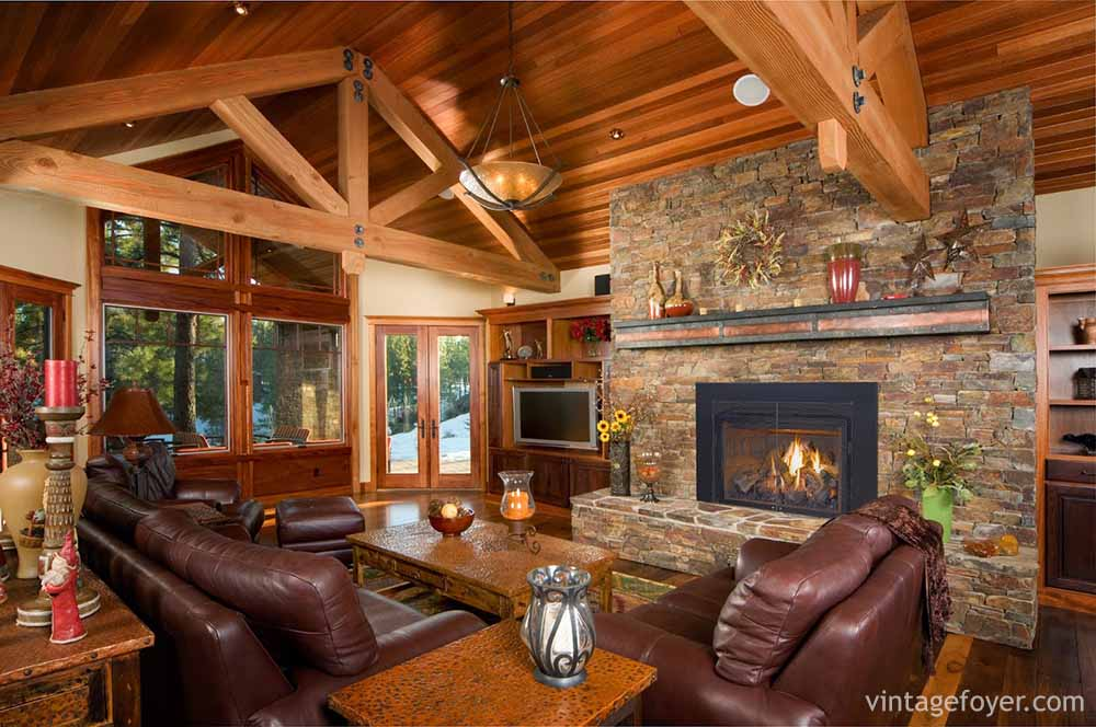 The Contrasting Wood Ceiling And The High Beams Gives This Living Room A  Natural Cabin Look. The Dark Stone Fireplace Adds To The Comfort And The  Mauve ...