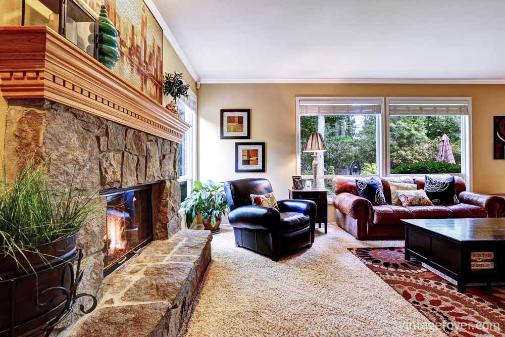 44 Cozy Living Rooms & Cabins with Beautiful Stone Fireplaces