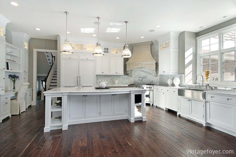 Dark Toned Hardwood Flooring, White Shaker Cabinetry Design, Large Open  Concept, Apron Sink, And Stainless Steel Appliances.