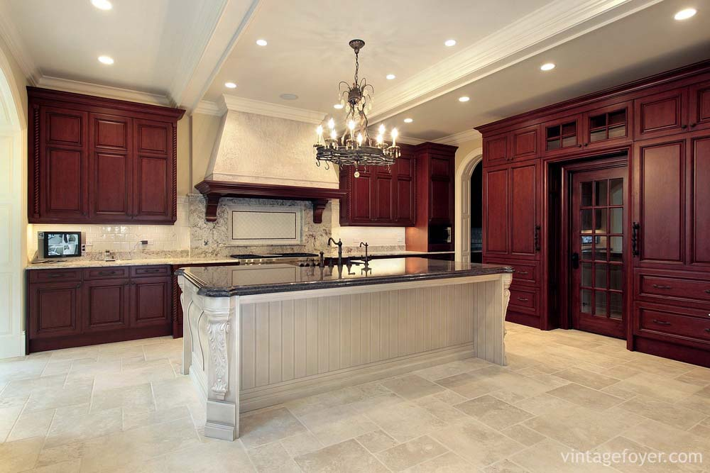 Dark Cherry Cabinetry With Contrasting White Island, Beautiful Black Marble  Custom Made For The Architectural Details In The Island.