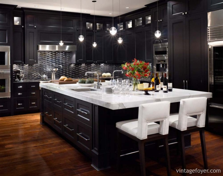 "Dark tones in this kitchen with contrasting ""pops"" of white and high end appliances offer a modern twist to this traditional kitchen."