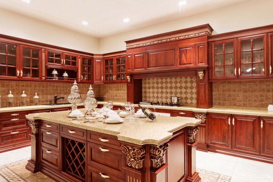 Elegant cherry cabinetry with grand wood carvings