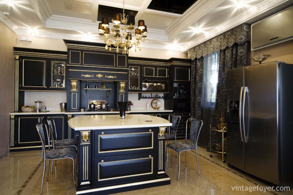 Custom Black Cabinets Large Stainless Steel Appliances Contrasting White Countertops And Extravagant Lighting