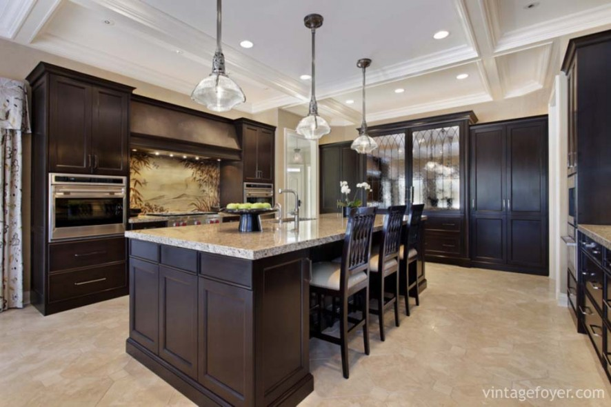 Luxury kitchen in upscale home with dark wood cabinetry