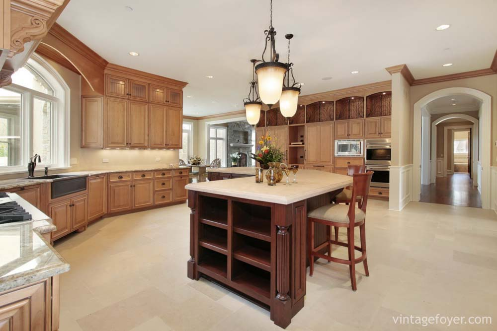 Large Open Concept Kitchen, Cream Toned Porcelain Tile, Large Dark Cherry  Hardwood Island With White Marble Countertop.