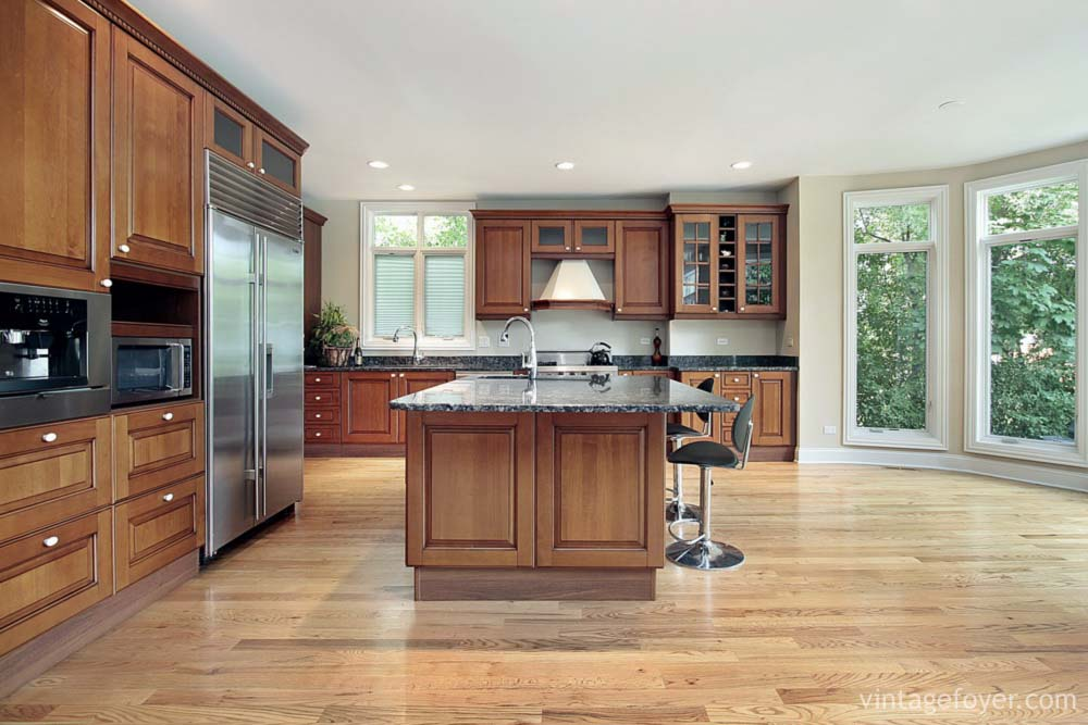 Cherry wood cabinets with stainless steel appliances best for Country living light mahogany kitchen island