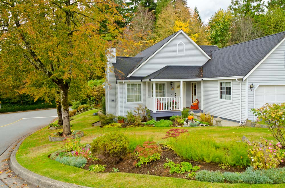Delightful Suburban Front Yard Landscaping Ideas Part - 12: This Cape Cod Style Cottage Is Hugged By A Front Yard With A Gorgeous  Manicured Lawn Featuring A Merry Mix Of Perennials In Mulch Beds.