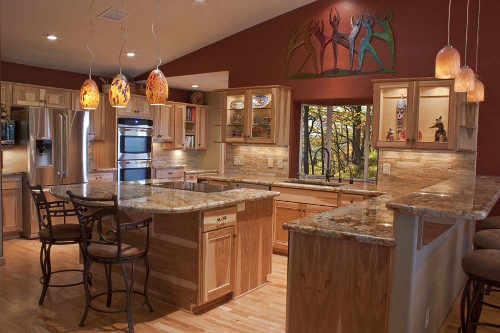 Marvelous The Natural Earth Tones Contrast Nicely With The Wall Color And Create A  Warm Look In This Kitchen. It Is Definitely A U Shaped Layout, But The  Design ...