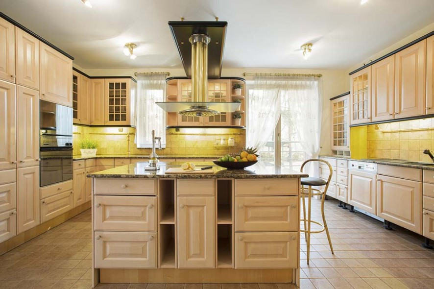 Old fashioned spacious kitchen with island
